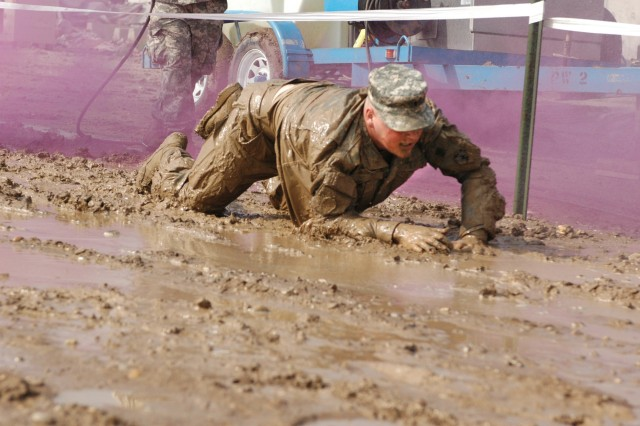 A Soldier does the low crawl.