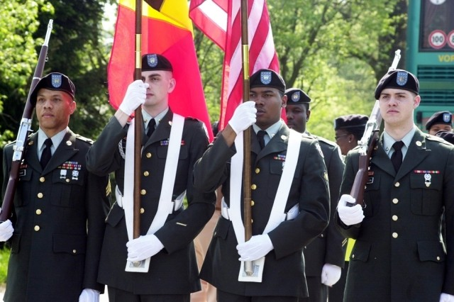 (From left) Sgt. Edward Murray, Spc. Clint McKinley, Spc. Terrence Hicks and Pfc. Kevin McPherson, assigned to Landstuhl Regional Medical Center, Germany, served as the color guard for an April 28, 2007, ceremony in Wereth, Belgium.  The ceremony commemorated 11 black Soldiers assigned to the 333rd Field Artillery Battalion during World War II, who were killed by the German SS on Dec. 17, 1944, during the early stages of the Battle of the Bulge.