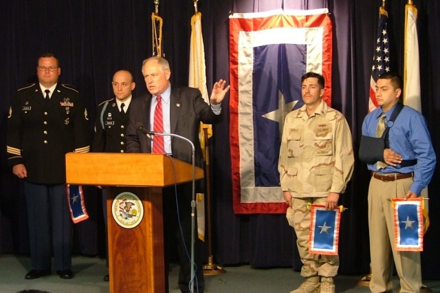 Illinois Lt. Gov. Pat Quinn holds a press conference to announce the first annual Silver Star Banner Day in the State of Illinois. Honored during the ceremony were Staff Sgt. Michael Erlandson, Chicago Recruiting Battalion, Sgt. Neal Bonham, Chicago Recruiting Battalion, Petty Officer 2nd Class Harold Beville, Sauk Village, Ill. and Petty Officer 3rd Class (ret.) Jose Sanchez, Freeport, Ill.