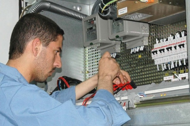 An Iraqi worker tests one of two new 33kV substations recently built in Fallujah to upgrade the city's electrical distribution network.