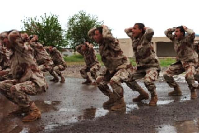 Iraqi Army basic trainees perform calisthenics during a daily physical training hour at the K-1 Iraqi Army Base near Kirkuk.