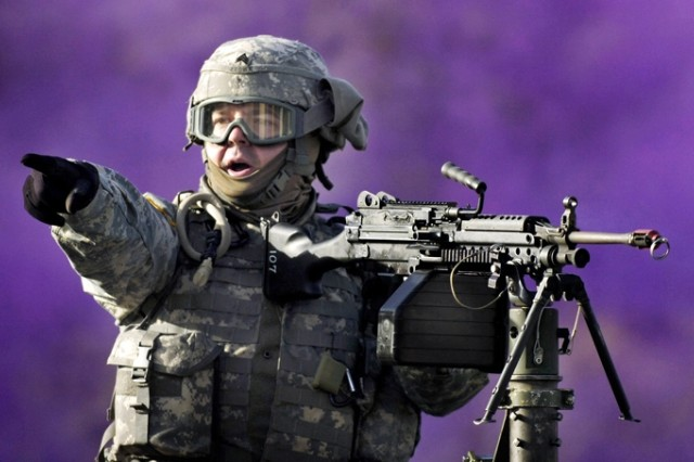 Sgt. Edgar Brown shouts to a nearby gunner during a simulated convoy attack.
