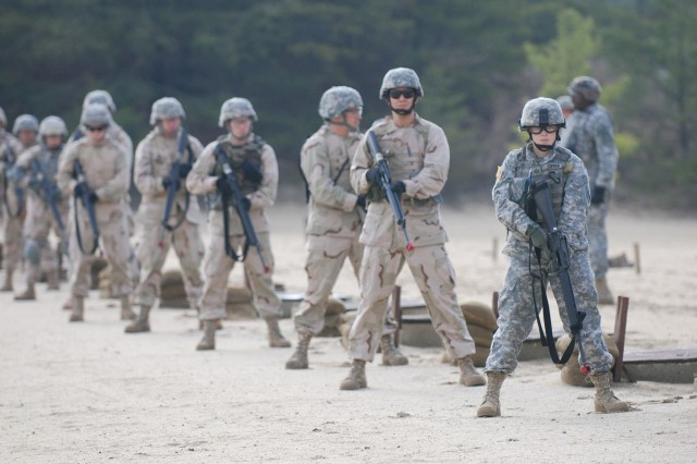 Soldiers and Airmen participate on the short-range marksmanship event, designed to teach how to respond with fast, effective fire to a surprise attack at close range.