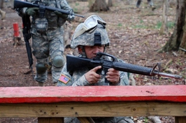 Staff Sgt. James Blaine and Sgt. Kelly Longbine negotiate the combat lifesaver course.