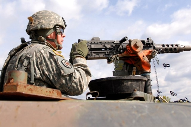 Sgt. 1st Class Marty A. Collins engages targets with an M-2 machine gun at the familiarization range.
