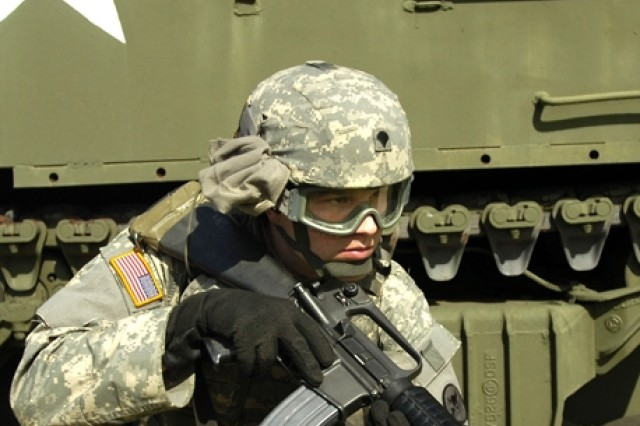 Spc. Charles Siler provides security for fellow Soldiers.