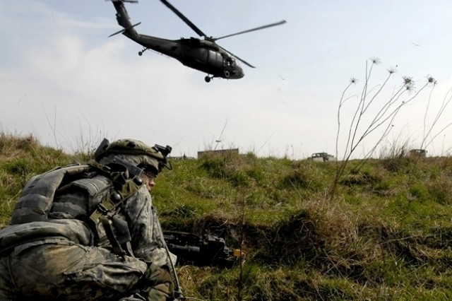 A Soldier provides security after dismounting a UH-60 Black Hawk helicopter.
