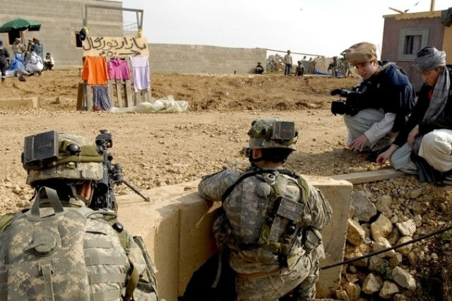 Soldiers train in simulated Middle Eastern settings, complete with role players.
