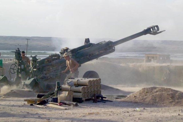 British Soldiers fire an M-777 155 mm howitzer at identified Taliban fighting positions near Sangin City.