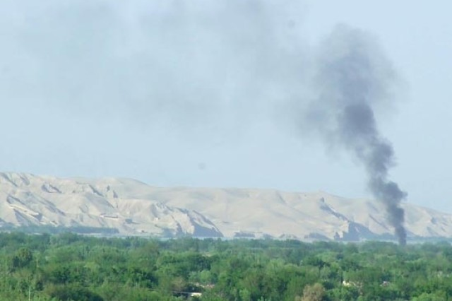A plume of smoke rises from the artillery strike on a Taliban position.
