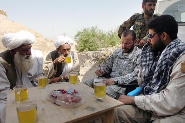 A Special Forces company commander meets with village elders and 1st Kandak, 209th Afghan National Army Corps counterparts to discuss military operations in Helmand Province.