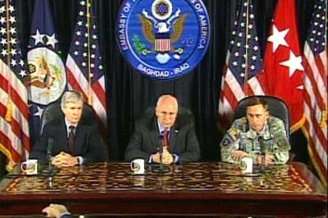 Vice President Dick Cheney (center), Multi-National Force-Iraq Commander Gen. David Petraeus (right), and U.S. Ambassador to Iraq Ryan Crocker (left), speak with reporters in Iraq.