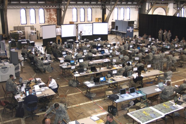 "In addition to participating in domestic crises nationwide, thousands of National Guard Soldiers also are participating in emergency preparedness exercises. Here, Soldiers from the National Guard, active and Reserve units, along with government agencies and emergency responders, participate last week in Exercise Ardent Sentry-Northern Edge, in the command center at the Cranston Street Armory, Providence, R.I. Personnel are evaluating their response to ""Hurricane Yvette,"" a fictional Catogory-3 hurricane that hit the coast of Rhode Island May 3."