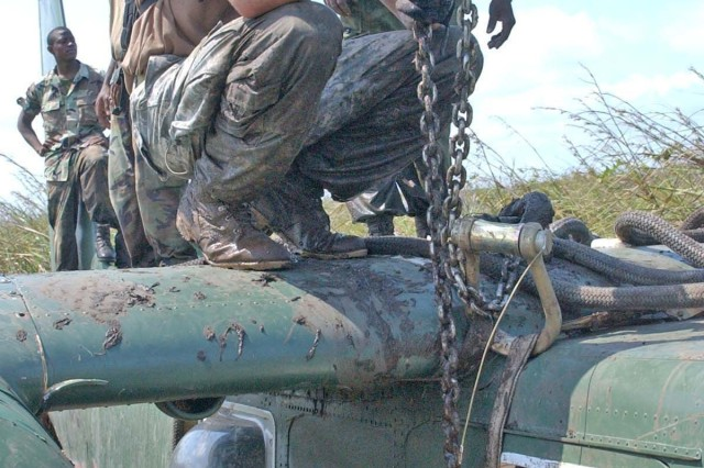 Sgt. 1st Class Mike Parks, a quality control team leader, measures the chain used for the slingload.