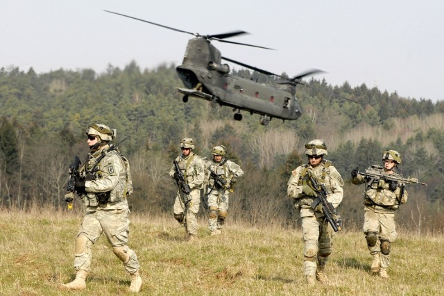 Soldiers go on a patrol after being airlifted to their starting point.