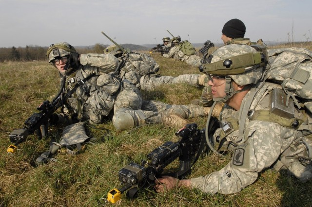 Soldiers provide security after dismounting a CH-47 Chinook helicopter.