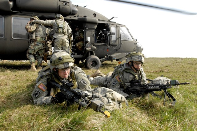 Soldiers provide security after dismounting a UH-60 Black Hawk helicopter.