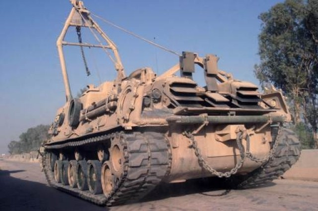The M88 provides towing, winching, and hoisting operations to support battlefield recovery operations and evacuation of heavy tanks and other tracked combat vehicles.  Entered Army Service 1997  Description and Specifications The M88A2 HERCULES is a full-tracked, armored vehicle that uses the existing M88A1 chassis but significantly improves towing, winching, lifting, and braking characteristics. The HERCULES is the primary recovery support for the Abrams tank fleet, the heavy Assault Bridge, and heavy self-propelled artillery. Length: 338 in   Height: 123 in Width: 144 in Weight: 70 tons   Speed: 25 mph w/o load; 17 mph w/ load   Cruising range: 200 mi   Boom capacity: 35 tons   Winch capacity: 70 tons / 670 ft   Draw bar pull: 70 tons   Armament: One .50-caliber machine gun   Power Train: 12 cylinder, 1050 hp air-cooled diesel engine with 3-speed automatic transmission   Crew: 3  Manufacturer United Defense, L.P. (York, PA)