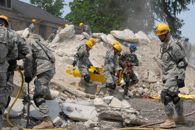 Simulated wounded are dug out of the rubble of collapsed building by members of the Guard's newly formed Chemical, Biological, Radiological, Nuclear Enhanced Response Force Package, or CERFP teams, while training as part of Vigilant Guard May 12 at the Muscatatuck Urban Training Center, Ind. The CERFP includes search and extraction, decontamination, medical and command and control elements of both the Army and Air National Guard.