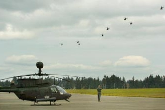 Kiowa Warriors from B Trp.,4-6 Air Cav. take off from Gray Army Airfield en route to the Port of Grays Harbor May 1.