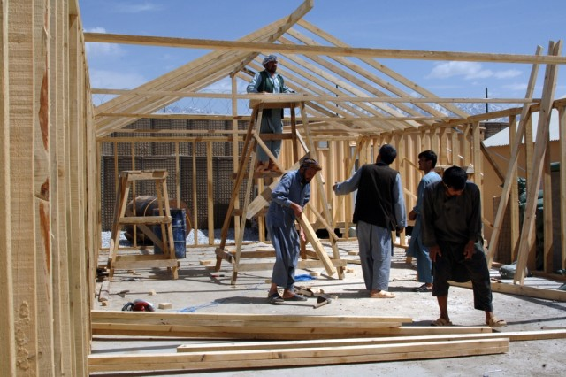 Afghan workers construct a new building for the Afghanistan National Army in Tagab District, Kapisa Province, Afghanistan, April 30.
