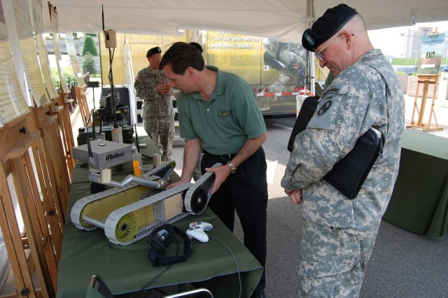 A FCS Program member shows a Soldier the modularity of the small unmanned ground vehicle (sugv) at the Pentagon on May 11, 2007.