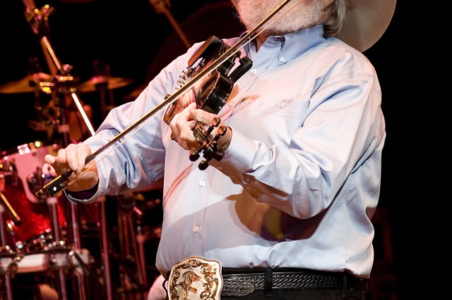 Renowned musician Charlie Daniels saws his fiddle during the opening number of The Charlie Daniels Band's set at the Volunteer Jam show held in Tampa, Fla., May 11. A strong military supporter, Mr. Daniels paid special tribute to servicemembers in the audience.