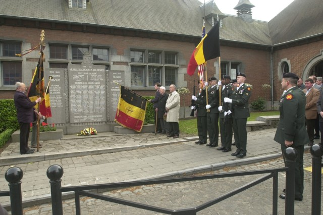 A U.S. Army Garrison Benelux Color Guard team of four Soldiers presents the colors during a remembrance ceremony honoring those killed in World War II as part of Victory in Europe ceremonies across the garrison footprint on May 8 in Chièvres Belgium. Ceremonies were also held in Ath, Brugelette and Mons.