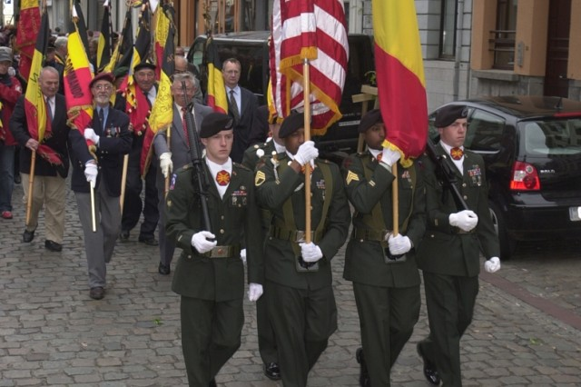 U.S. Army Garrison Benelux Color Guard team under the direction of Sgt. 1st Class Thomas Jessen, led the procession of Belgian patriot organizations, civic leaders and well wishers celebrating Victory in Europe Day, May 8, in Ath, Belgium. Ath was one of four communities in which Soldiers participated in VE-Day remembrance ceremonies. The Soldiers also participated in ceremonies in Mons, Brugelette and Chièvres community.