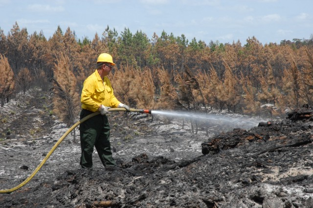 A Soldier from the 164th Air Defense Artillery Brigade, Florida Air National Guard helps the Florida Division of Forestry put out a wildfire in Starke, Fla., May 14.