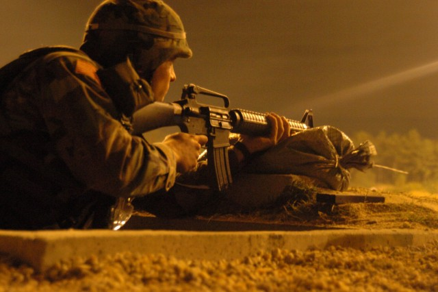 Sgt. Karen Antonyan qualifies at night with his M-16 A2 rifle on the last day of the 2005 Department of the Army NCO and Soldier of the Year Competition at Fort Lee, Va.