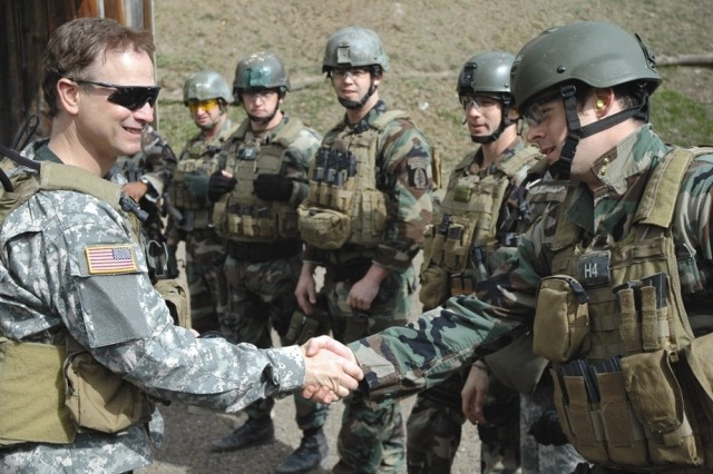 Actor Gary Sinise shakes hands May 11 with Soldiers of the 1/10th Special Forces Group (Airborne) at Stuttgart, Germany.