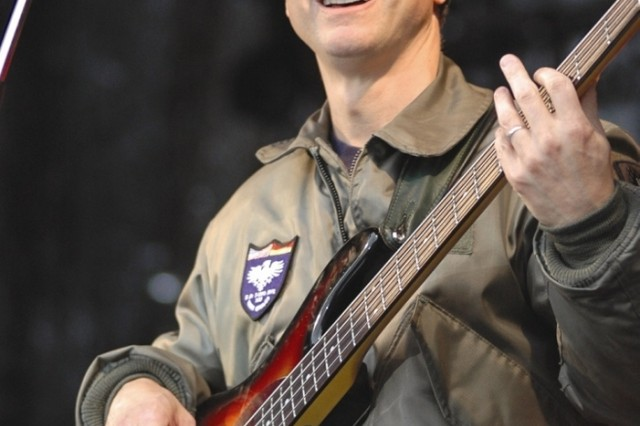 Gary Sinise plays his bass guitar for a crowd of 750 people during a May 11 show at Stuttgart, Germany, one of six concerts that his Lt. Dan Band played for U.S. servicemembers in Europe.