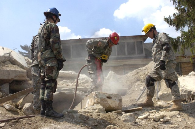 "Soldiers search the rubble for ""survivors"" after the simulated detonation of a 10-kiloton nuclear device."