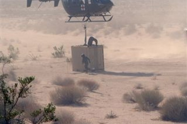 The Operational Test Command tests the UH-72A Lakota's ability to lift a container in Barstow, Calif.