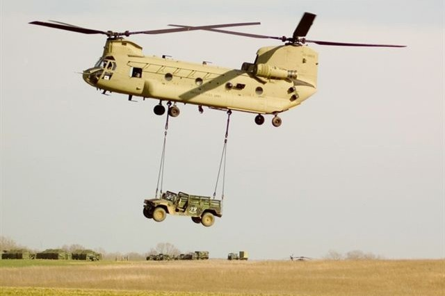The new Chinook, the CH-47F, lifts a Humvee as part of an operational test conducted at Fort Campbell, Ky.