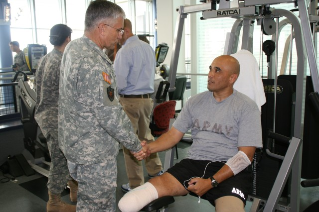 Master Sgt. Dan Robles tells Army Chief of Staff Gen. George W. Casey Jr. about his experiences in the Army 10-Miler at the Center for the Intrepid, the Army's state-of-the-art rehabilitation facility. Master Sgt. Robles is a bilateral amputee wounded by an improvised explosive device while on patrol south of Baghdad in April 2006.