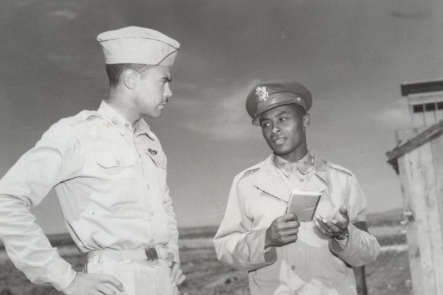 Lieutenant Colonel Benjamin O Davis Jr.,commanding officer of the 99th Fighter Squadron talking with Ollie Stewart, war correspondent, near Fez, French Morroco. May 12, 1943. (WW2 Signal Corps Collection).