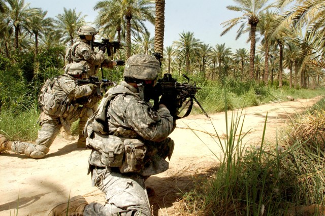Soldiers take aim at suspected insurgents.