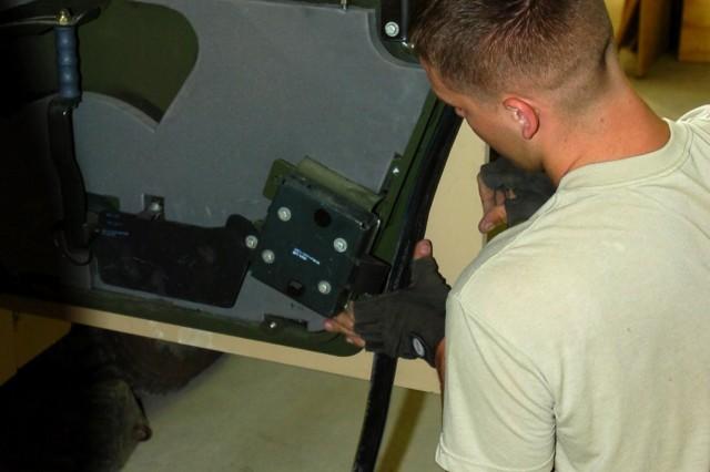 82nd CAB Mechanics Install Frag- 5 Armor Field Kits