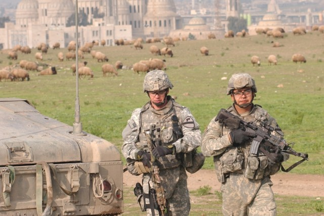 Soldiers from Company D, 2nd Battalion, 7th Cavalry Regiment, 4th Brigade Combat Team, 1st Cavalry Division, patrol an area near Mosul, Iraq.