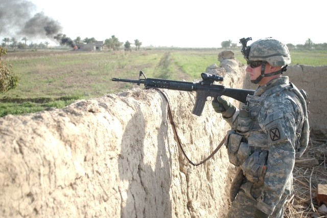 Sgt. Justin Wisniewski, from Battery A, 2nd Battalion, 15th Field Artillery Regiment, 2nd Brigade Combat Team, 10th Mountain Division, provides security for fellow Soldiers in Lutafiyah, Iraq.