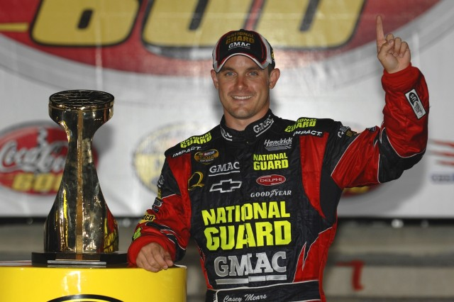 Driver Casey Mears takes the trophy.