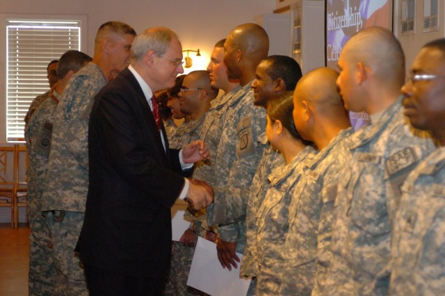 U.S. Ambassador to Afghanistan William Wood and Maj. Gen. David Rodriguez congratulate the Soldiers, who are now U.S. citizens.