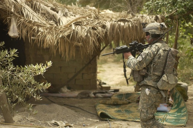 A Soldier from 1st Battalion, 12th Cavalry Regiment, 3rd Brigade Combat Team, 1st Cavalry Division clears the suspected prison camp where 41 people were liberated.