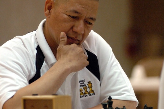 Staff Sgt. Rudy Tia Jr. of Camp Speicher, Iraq, ponders his next move en route to winning an unprecedented seventh All-Army Chess Championship May 18 at the Fort Myer Community Center.