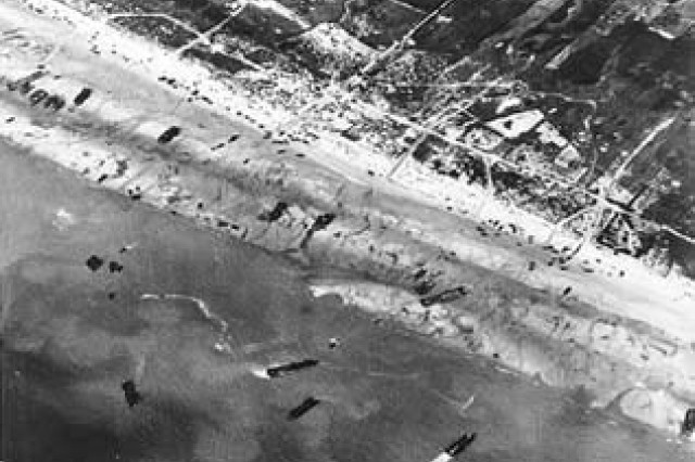 Army Air Corps photographers documented D-Day beach traffic, as photographed from a Ninth Air Force bomber on June 6, 1944. Note vehicle lanes leading away from the landing areas, and landing craft left aground by the tide.