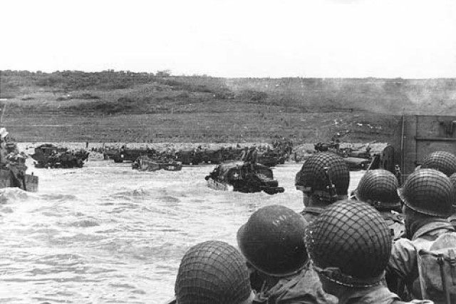 Soldiers crowd a landing craft on their way to Normandy during the Allied Invasion of Europe, D-Day, June 6, 1944.