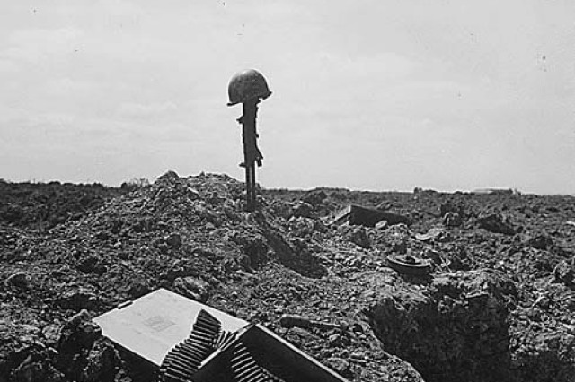 The spirit of the American Soldier: this beachhead is secure. Fellow Soldiers erected this monument to an American Soldier somewhere on the shell-blasted coast of Normandy.