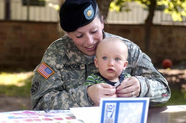 Maj. Jeneen Johnson, U.S. Army Garrison Kaiserslautern emergency services director, fingerprints her 11-month-old son, Gage, May 24 for a ChildPrint ID Kit that was distributed during the garrison's National Missing Children's event.